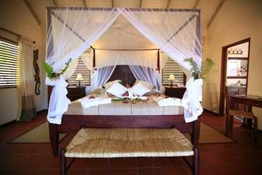 Intérieur de la chambre vue Océan avec lit à baldaquin... Une chambre avec beaucoup de charme !