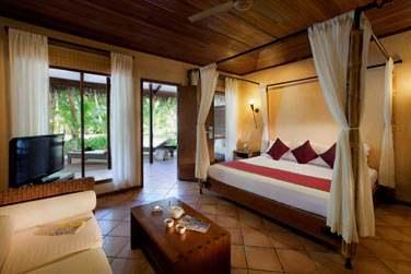 Intérieur de votre Beach Villa avec lit à baldaquin... Espace et confort garantis