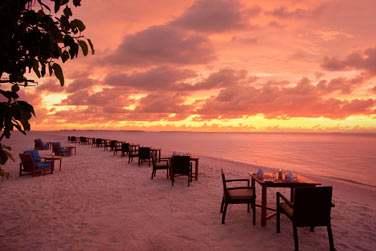 Dîner sur la plage face au fabuleux coucher de soleil au Islander Grill