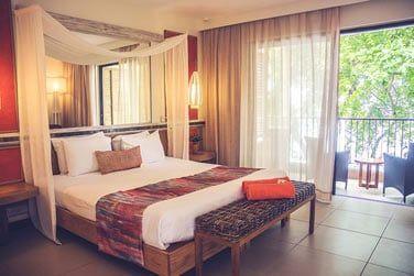 Les chambres Deluxe sont décorées dans des tons chaleureux à l'image de cette Afrique si fascinante.