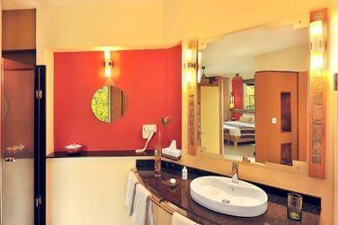 La salle de bain des chambres Deluxe