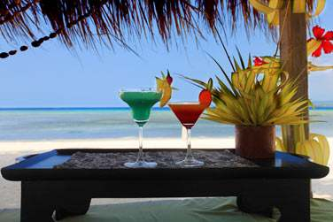 Un verre les pieds dans le sable ?