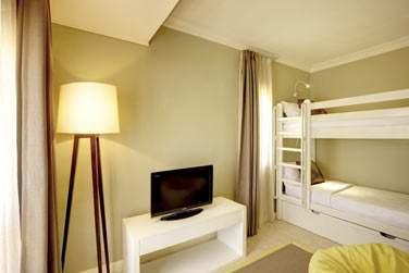 La chambre des enfants de la chambre Famille avec lits superposés