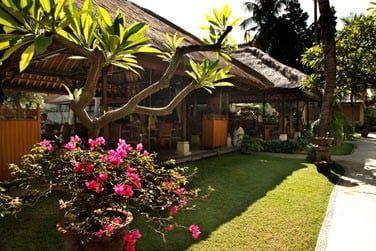 permettant de profiter de la vue sur les jardins tropicaux de l'hôtel..
