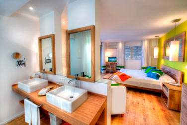Salle de bain, ouverte sur la chambre dans le Cottage Supérieur