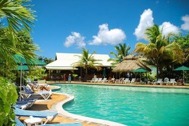 Cet hôtel au charme créole est idéalement situé à proximité d'une belle plage de sable blanc