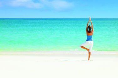 Quel beau cadre pour une séance de yoga sur la plage...