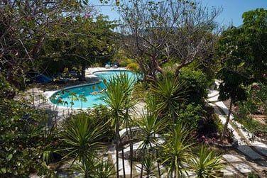 Cette résidence hôtelière vous accueille dans un jardin luxuriant de 2 hectares