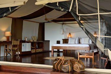 Chambre des suites, spacieuses et ouvertes sur l'extérieur