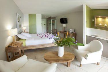 Les chambres avec coin salon et kitchenette
