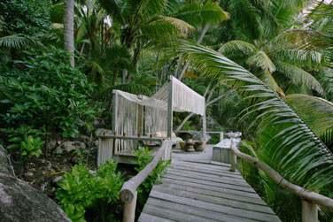 à l'hôtel North Island aux Seychelles.