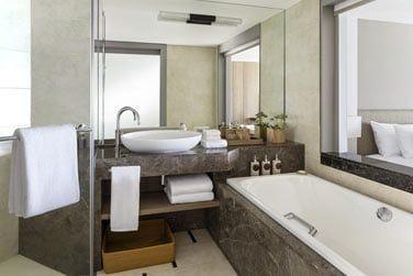 Salle de bain des chambres Deluxe