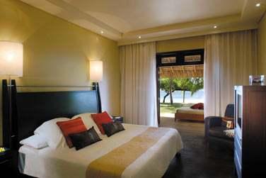 Une chambre de la Villa Présidentielle, ouverte sur le jardin privé. Vue sur la mer