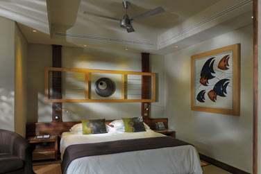 Une chambre double de la villa 3 chambres avec piscine